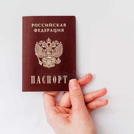 depositphotos_62899281-stock-photo-russian-passport-in-hand-on